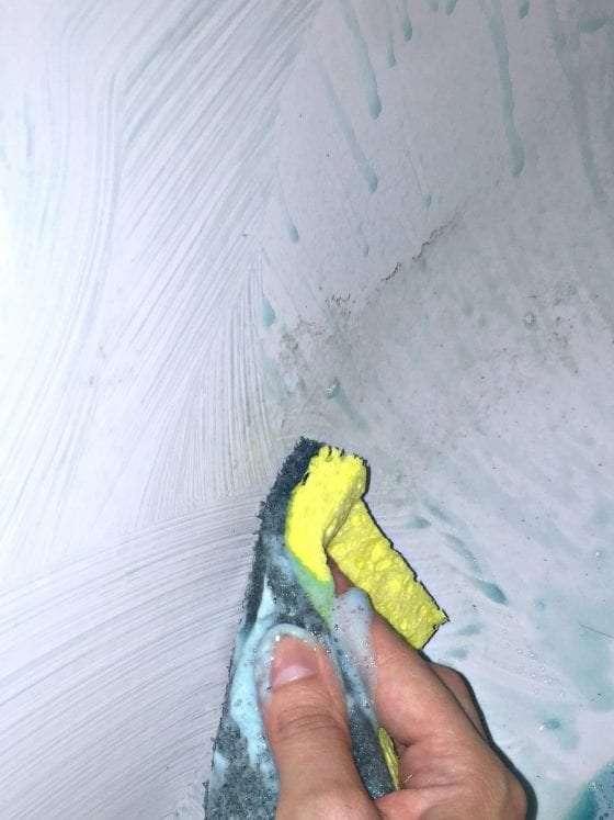 green sponge scrubbing