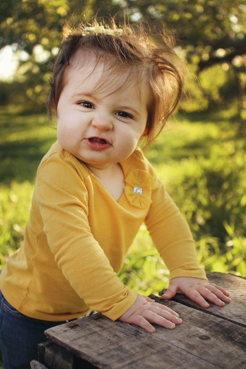 toddler girl making face