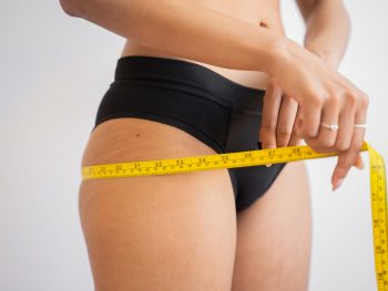 woman measuring leg weight loss diet