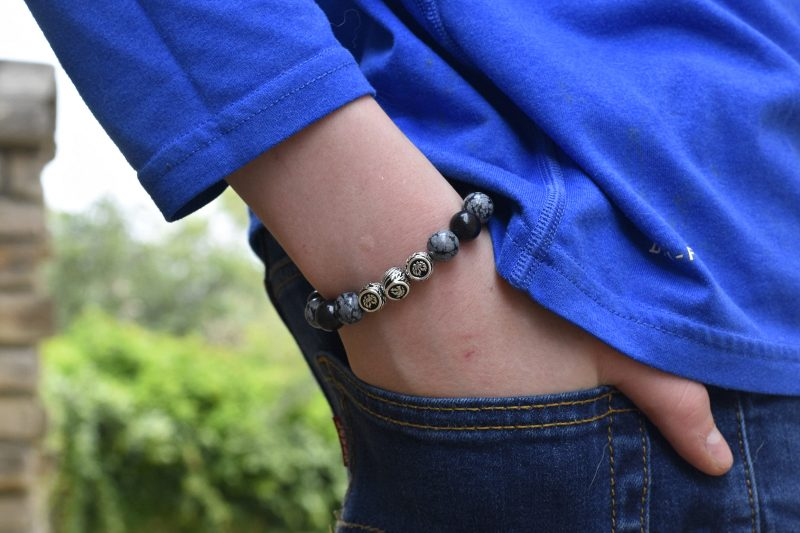 Azuro Republic bracelet with hand in pocket