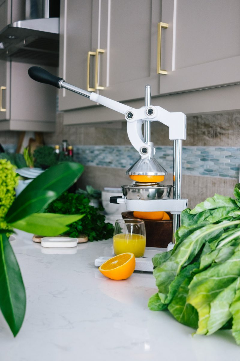 marble counter with juicer in kitchen