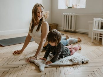 woman and kid doing yoga