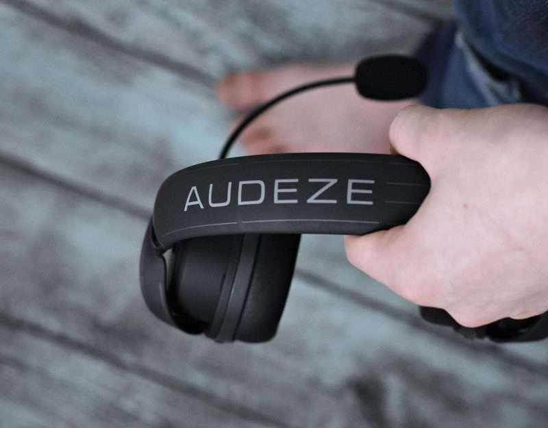 holding audeze headphones