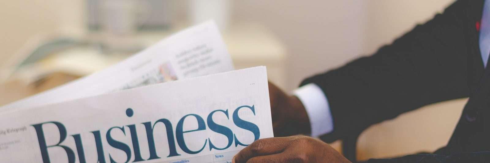 man holding business newspaper